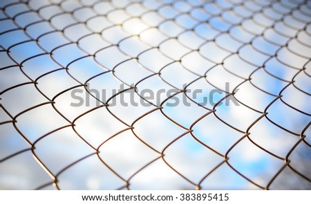 Blue sky behind a metal grate - stock photo