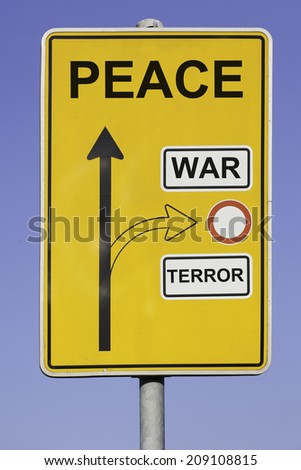 blue sky behind a yellow road sign with an vertical arrow pointing to peace and a second arrow pointing to war and terror at the right hand side. - stock photo