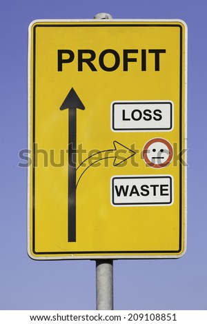 blue sky behind a yellow road sign with an vertical arrow pointing to profit and a second arrow pointing to loss and waste at the right hand side. - stock photo