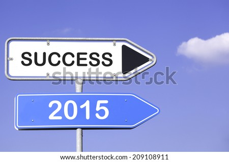 blue sky behind two white and blue road signs  on a metal mast with arrows to the right hand side showing the way to success 2015 - stock photo