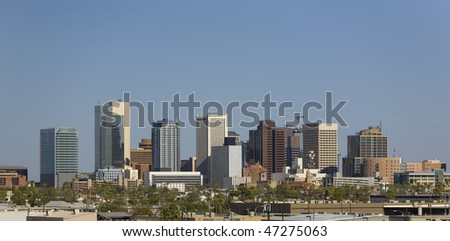 Blue Sky Cityscape of Phoenix Downtown in the Midst of Arizona Hot Summer - stock photo