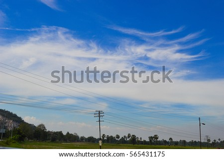 Blue sky, cloud and view of fields of green
