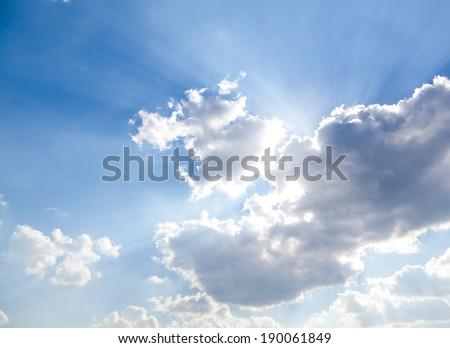 blue sky, clouds and sun behind the clouds, sun, sunrise and sunset - stock photo