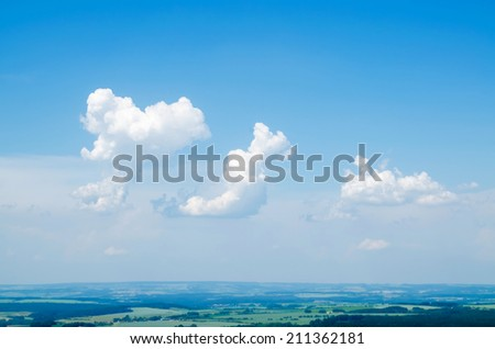Blue sky, clouds and sun light background - stock photo