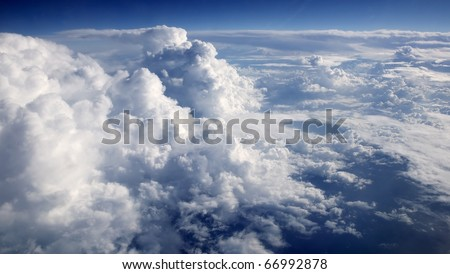 blue sky clouds view from aircraft airplane sunny day - stock photo