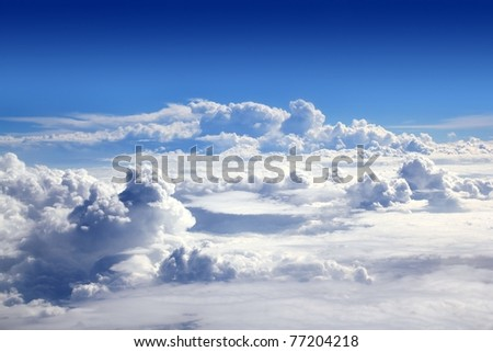 blue sky high view from airplane clouds shapes - stock photo