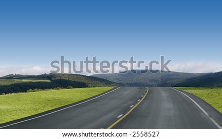 Blue sky highway through the green mountains of Germany. - stock photo