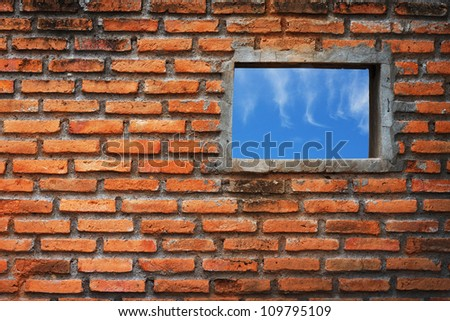 blue sky hole in aged brick wall background - stock photo