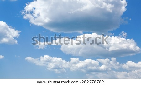 blue sky in cumulus clouds, background photo