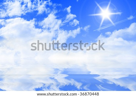 blue sky is reflected in water - stock photo