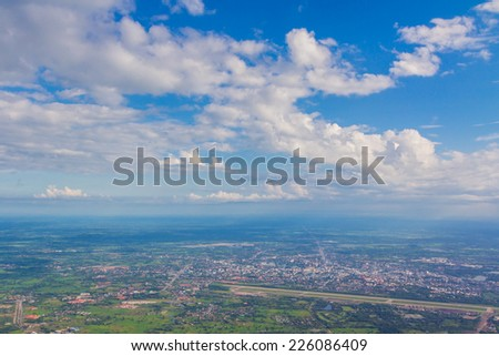 Blue sky land and white cloud background