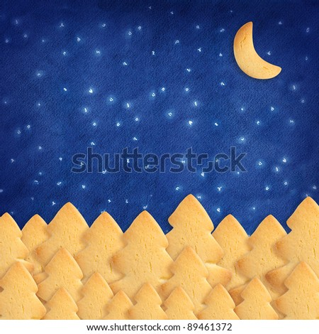 Blue sky made with homemade biscuit. Trees and Moon shape.