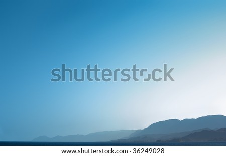 blue sky, mountains and sea backgrounds - stock photo