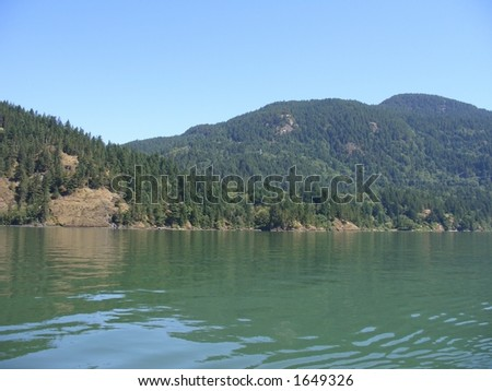 Blue sky, mountains, water - stock photo