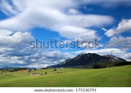 blue sky over alpine meadows, Bavaria, Germany - stock photo