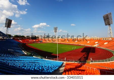 Blue sky over empty stadium - stock photo