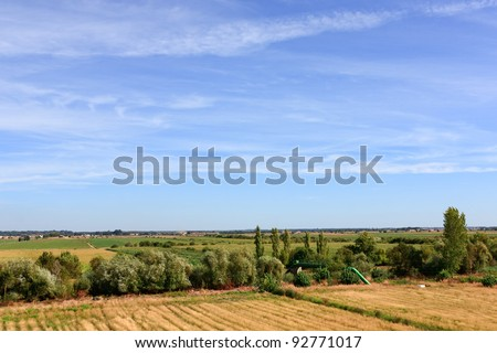 Blue sky over green field on Portugal lowlands