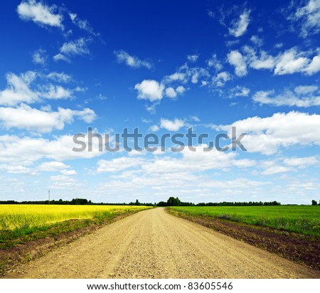 Blue sky over the ground road. - stock photo