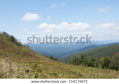 blue sky over the mountains - stock photo