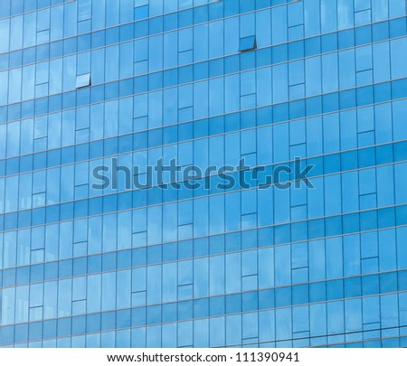 Blue sky reflected in the glass building. - stock photo