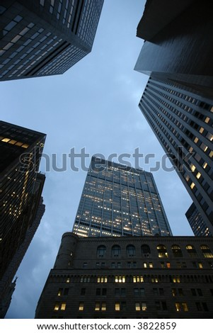 Blue sky seen through rising skyscrapers in downtown Manhattan, New York, NY, USA. - stock photo