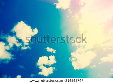 Blue Sky, Sun and Clouds, Light Background. Stylized Color Tone with Lens Flare - stock photo