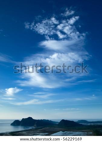 Blue Sky White Dragon Clouds - stock photo