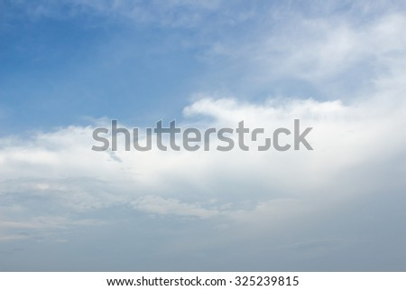 blue sky.white fluffy clouds in the blue sky.blue sky background with tiny clouds - stock photo