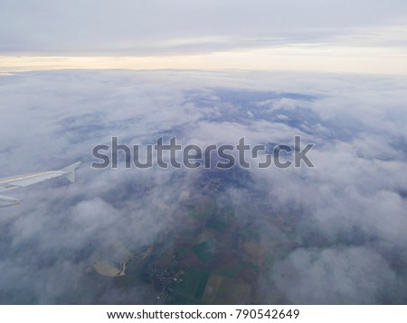 Blue sky, wing of an airplane, airplane in the sky, white clouds
