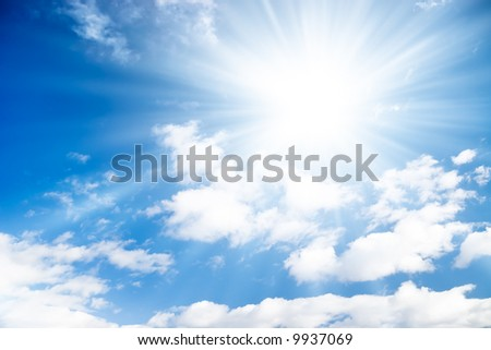Blue sky with bright sun. - stock photo