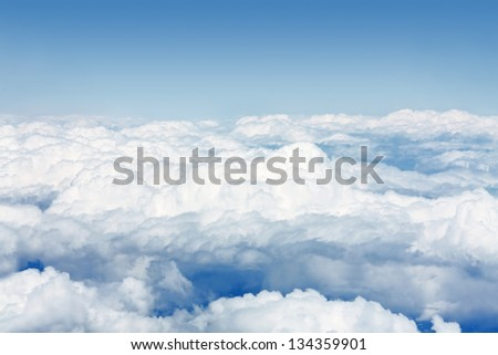 Blue sky with clouds aerial view - stock photo