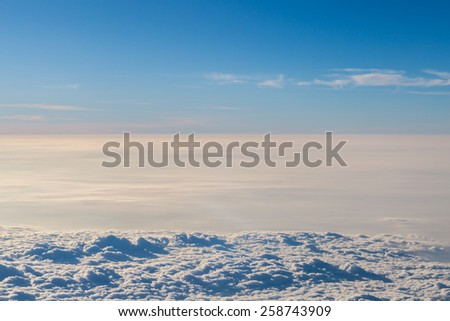 Blue sky with clouds aerial view froem the plane for blackground - stock photo