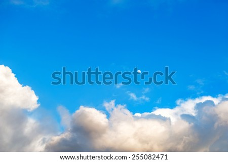 Blue sky with clouds and Moon - stock photo