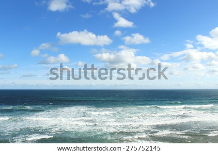 Blue sky with clouds and ocean
