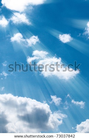 Blue sky with clouds and sun rays - stock photo
