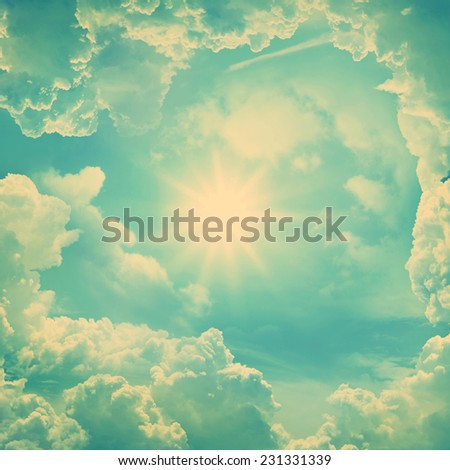 Blue sky with clouds and sun. Retro stale. - stock photo