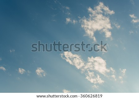 Blue sky with clouds and sunset background - stock photo