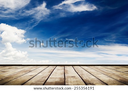 blue sky with clouds and wood planks floor background - stock photo