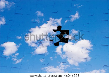 Blue sky with clouds as a puzzle (with a black hole instead of one piece) - stock photo