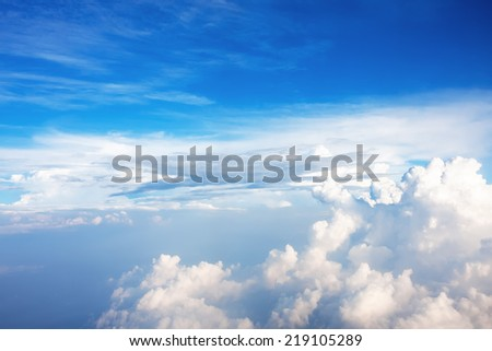 Blue sky with clouds, as background - stock photo