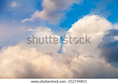 Blue sky with clouds at sunset - stock photo