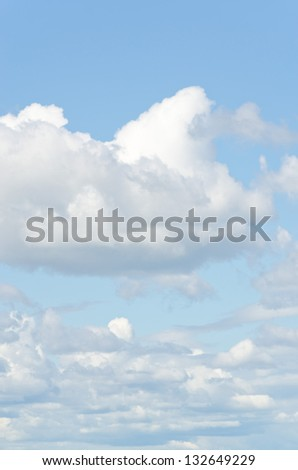 blue sky with clouds background vertical - stock photo