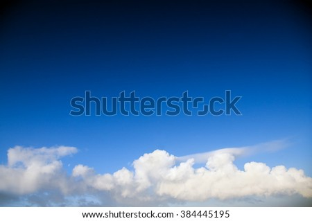 Blue sky with clouds closeup. - stock photo