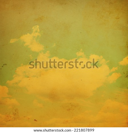 Blue sky with clouds in grunge and retro style.