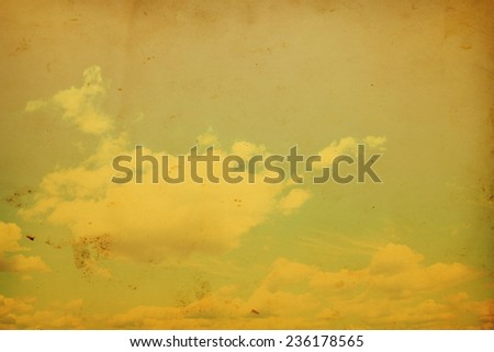 Blue sky with clouds in grunge and retro style. - stock photo
