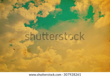 Blue sky with clouds in grunge style. - stock photo