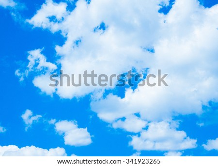 Blue sky with clouds. Nature background - stock photo
