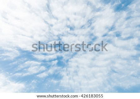 blue sky with clouds on sunshine day,effect radial blur, zoom effect