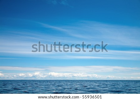 Blue sky with clouds  over Lake Ladoga - stock photo