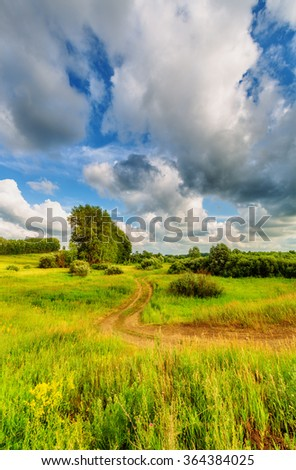 Blue sky with clouds over the hills (rural landscape) - stock photo